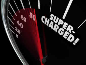 """An odometer with the red needle speeding up to the word """"supercharged."""""""