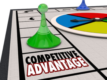 """A board game with a green and blue playing piece, a spinning board, and game squares. The focus is on one game square that reads, """"Competitive Advantage."""""""