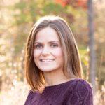 Head shot of Jess Zellmer in a deep purple sweater.