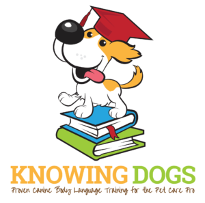 knowing dogs proven canine body language training for the pet care pro graphic of a dog with a red graduate's hat on its head while it stands on two books.